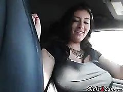 Big-chested shows her tits while she is driving