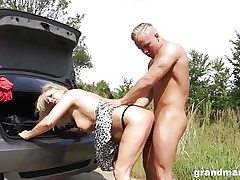 Grandma changes flat tire and bends over for some young cock