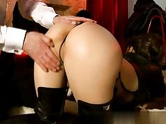 Sassy babe dressed in her high boots getting her fine plump booty slapped