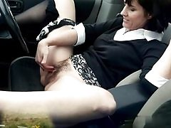 Muddy mature biotch frigs her poon hole on the back seat of her camper