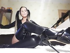 Hot whore on high heels and leather costume petting her ultra-kinky fuckbox crevasse
