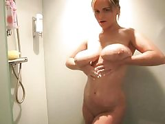 Blonde bombshell with phat boobs takes a sensual shower all alone
