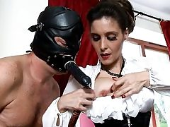 Nasty fellow is wearing a black leather mask boinking her mouth